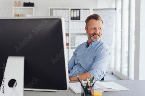 Vászonkép Relaxed businessman watching in amusement