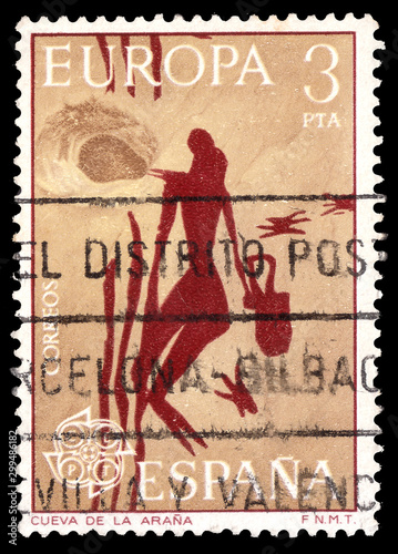 Obraz na plátne Stamp printed in the Spain with Woman Gathering Honey Mesolithic Rock Painting f