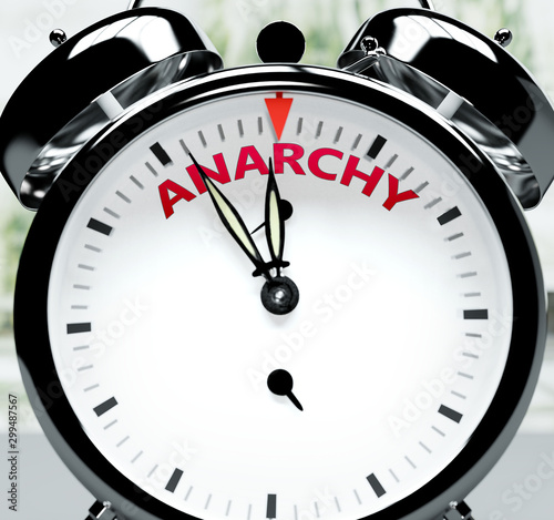 Photo Anarchy soon, almost there, in short time - a clock symbolizes a reminder that A