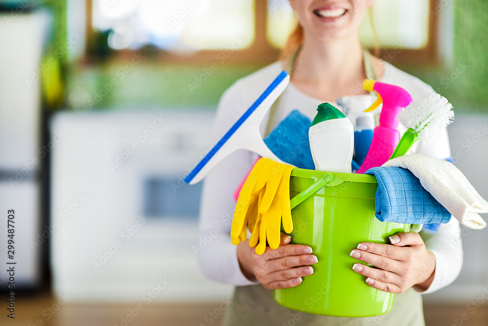 Fototapety, obrazy: Woman holding cleaning items in plastic bucket. Kitchen service washing concept.