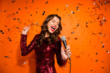 Portrait Of Positive Cheerful Girl Sing Song Enjoy Bachelor Party Event Have Fun Hold Microphone Wear Stylish Luxury Outfit Isolated Over Orange Color Background Serpentine Flying