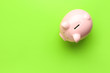 canvas print picture - Piggy bank on color background