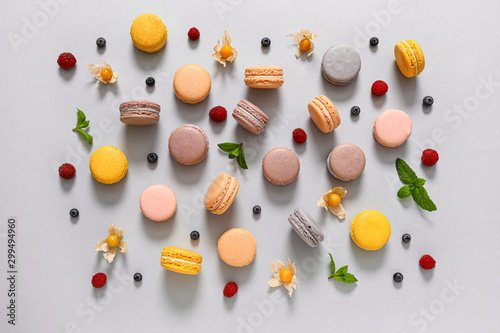 Photographie Assortment of tasty macarons on grey background