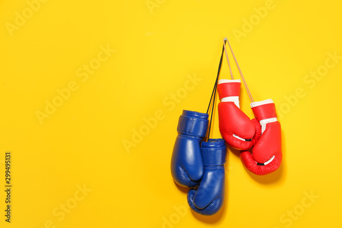 Boxing gloves on color background Fototapeta