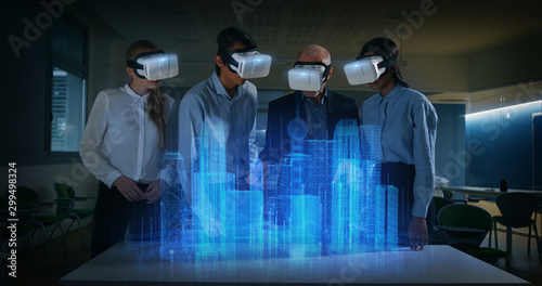 A group of modern designers are using futuristic sophisticated technology vr glasses with augmented reality holograms for a new project realization in an office Canvas Print