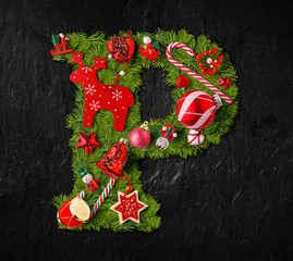 Letter P made of Christmas tree ornaments