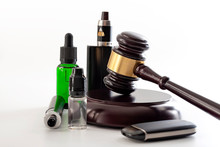 Legal Act To Restrict Vaping, Outlaw Smoking Electronic Cigarettes And Vape Ban Legislation Conceptual Idea With Judge Gavel, Vape Device And Bottle Of Ejuice Isolated On White Background