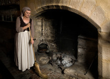 Woman Cleaning At Medieval Fir...