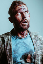 A Bloody Zombie Face With Possessed White Eyes. Zombie Makeup For Halloween,