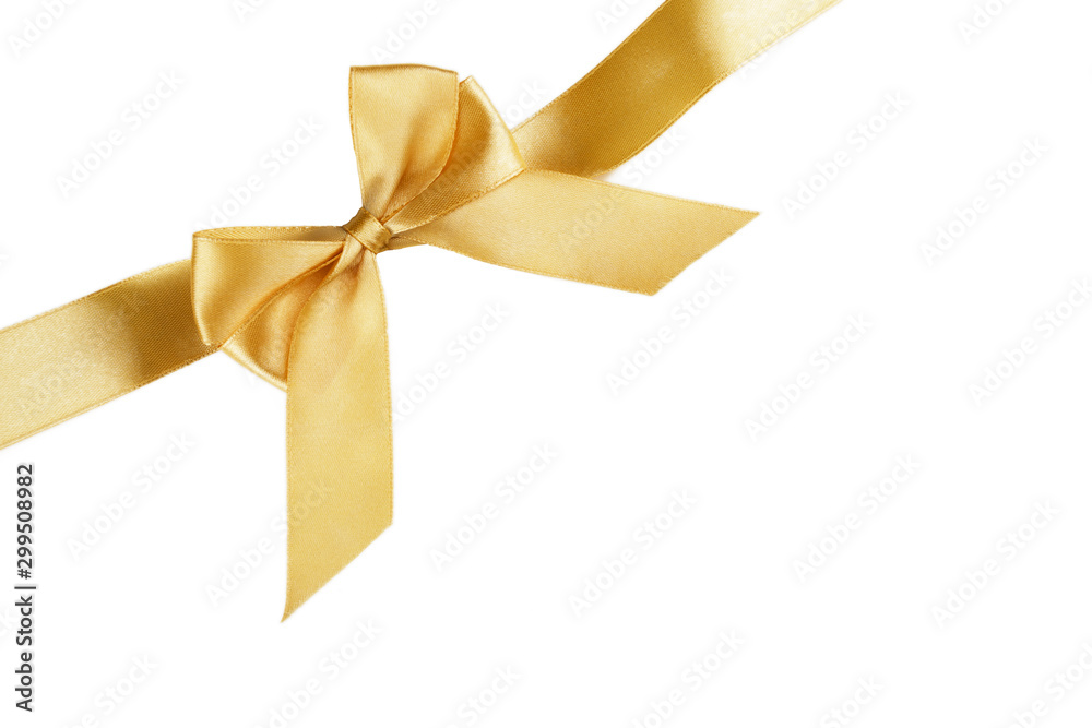 Fototapeta Christmas gold ribbon with bow isolated on white