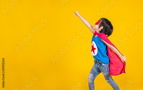 Obraz Portrait of asian little boy playing pretend to superhero. Happy young cut boy wearing hero costume, education childhood lifestyle, back to school concept - fototapety do salonu