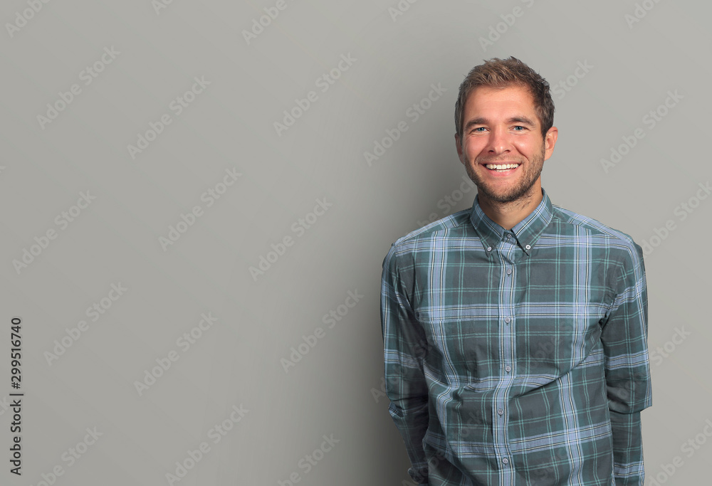Fototapety, obrazy: Young man in denim shirt is smiling