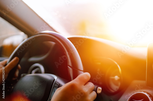 Fotografie, Obraz Close up of driver hands driving in road trip