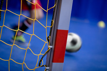 Indoor Soccer Background. Futsal Junior Player On Indoor Training. Soccer Goal With Yellow Net. Soccer Winter Class At School Indoor Futsal Court. Young Player In An Indoor Play-field