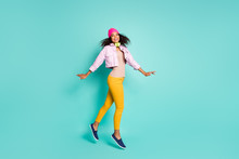Full Length Body Size Side Profile Photo Of Cheerful Positive Nice Pretty Charming Girl Dancing Jumping Wearing Yellow Trousers In Striped T-shirt Isolated Over Pastel Teal Color Background