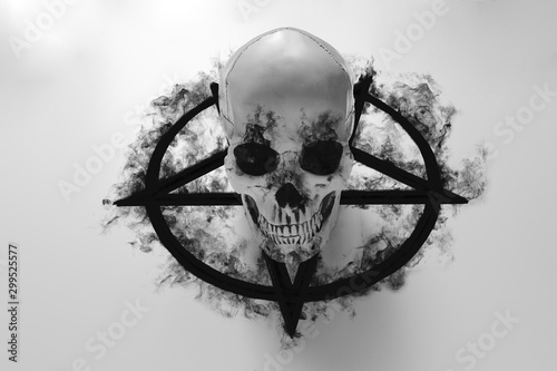 Fotografie, Tablou White human skull on top of black pentagram on white background with black smoke