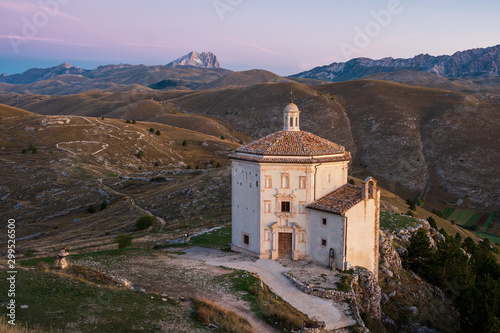 Printed kitchen splashbacks Purple Beautiful chapel Chiesa di Santa Maria della Pietà at dawn before sunrise with barren landscape and mountain of Corno Grande in background, Rocca Calascio, Abruzzo, Italy