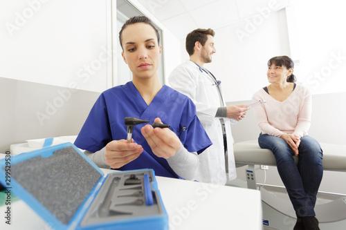 nurse preparing equipment for checking ears Canvas Print