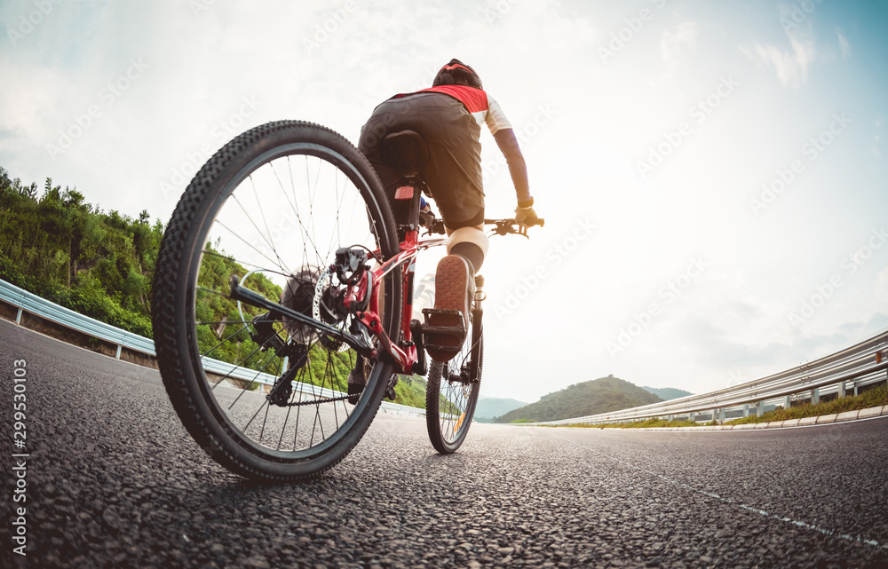Fototapety, obrazy: Woman cyclist riding Mountain Bike on highway