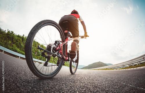 Woman cyclist riding Mountain Bike on highway Wallpaper Mural