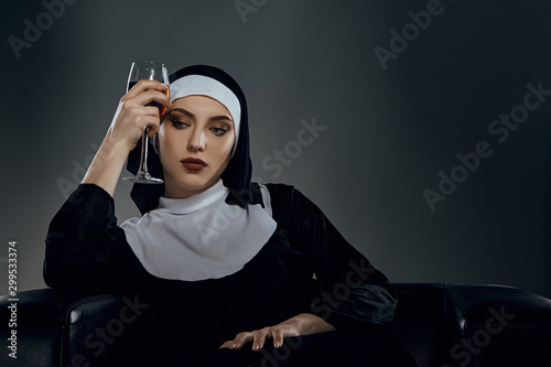 Cropped shot of a nun, sitting on a chair Canvas Print