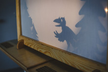 Teacher Do A Shadow Play Crow In Kindergarten Or Preschool. Child Play Concept Shadow Pantomime Shadowgraph For Children