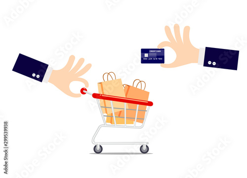 Cuadros en Lienzo Hand holding a credit card with shopping cart isolated on white background