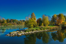 The River Mangfall Flows Into The River Inn, Near Rosenheim In Upper Bavaria, Trees In Autumn Colors On The Banks