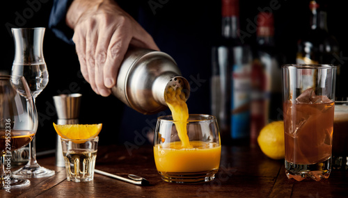 Barman serving a shaken alcoholic orange cocktail Wallpaper Mural