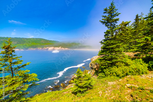 Photo View of Atlantic ocean and foggy Sand Beach in Acadia National Park, Maine
