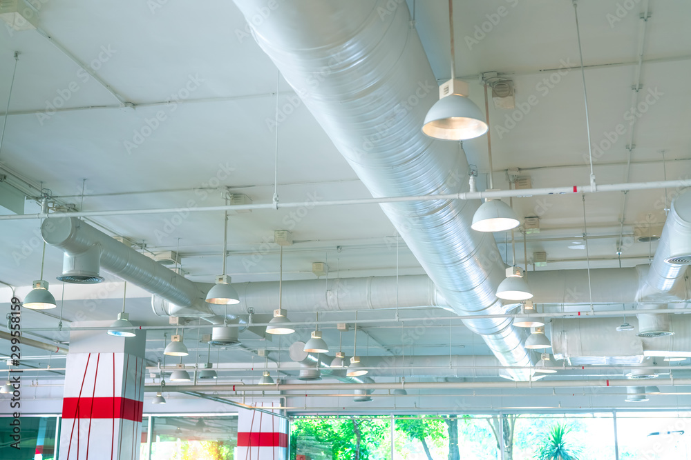 Fototapety, obrazy: Air duct, air conditioner pipe, fire sprinkler system. Air flow and ventilation system. Building interior. Ceiling lamp light with opened light. Interior architecture. Glass wall building.