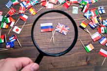 British And Russian Flags. Politics, Economics, Imports And Exports Concept
