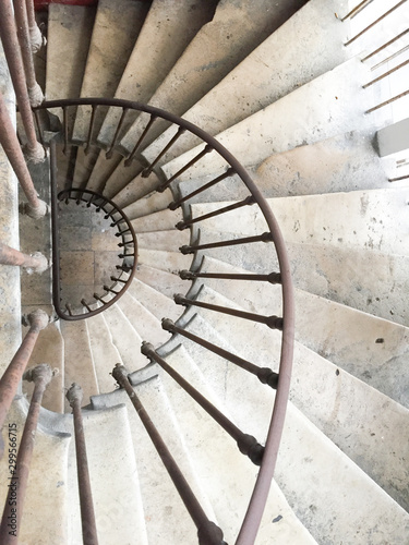 Fototapeta white circular staircase spiral stairs in old house