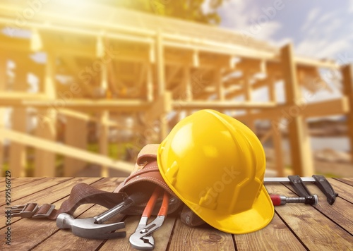 Fotografia  Yellow hard hat with tools
