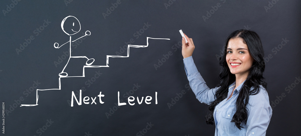 Fototapety, obrazy: Next level concept with young woman writing on a blackboard