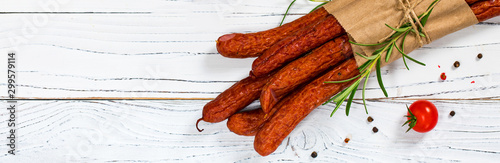Kabanos or Cabanossi Thin Dry Smoked Polish Sausage on White Wooden Background Wallpaper Mural
