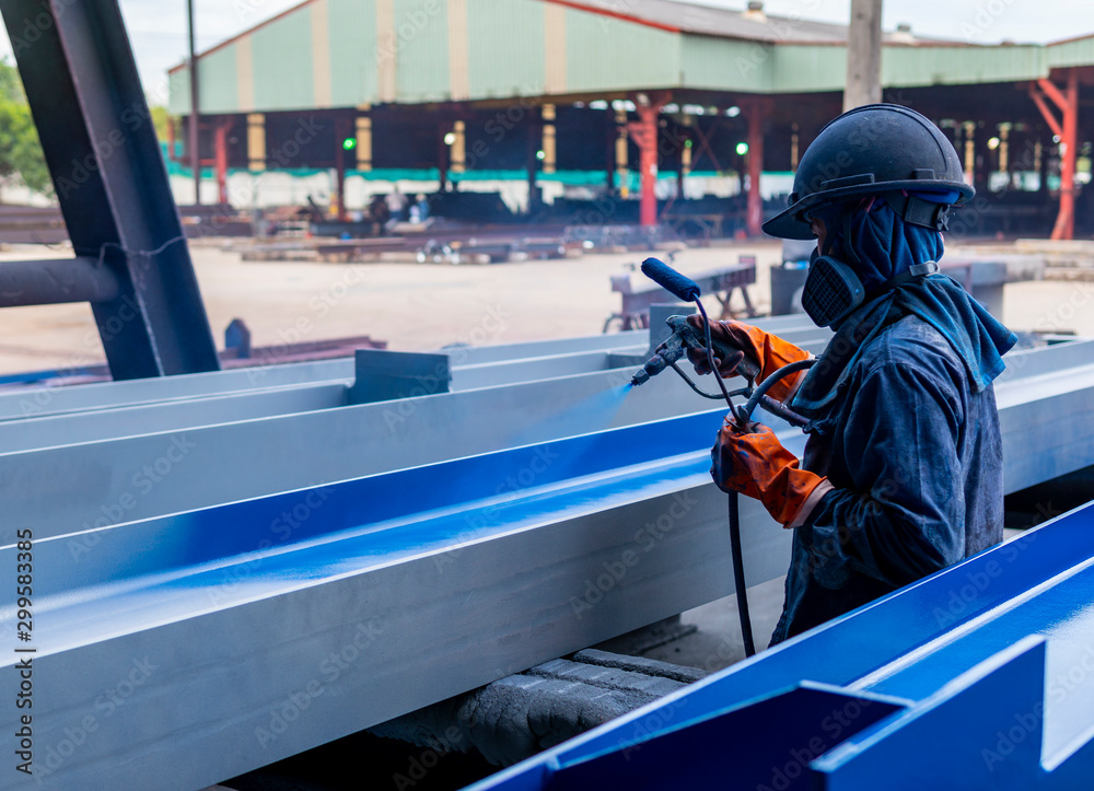 Fototapety, obrazy: The painter is working to painting the steel structure with spray gun.