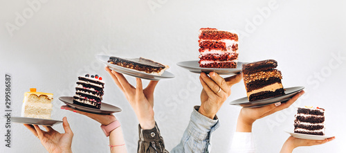 Fotografia, Obraz Concept for cafe or bakery with desserts: plates with different cakes in people'