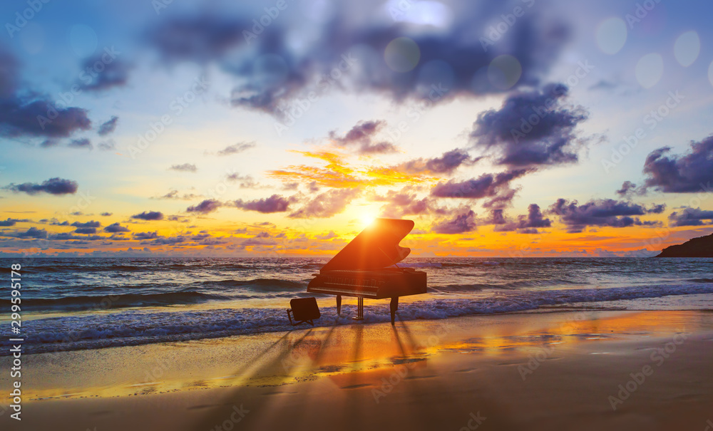 Fototapeta Music background.Melody and song concept in nature.Surreal image of grand piano in scenic sunset beach
