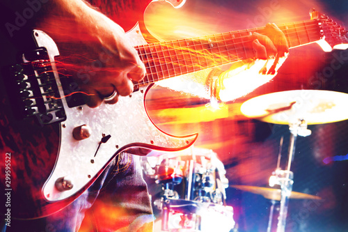Stage lights.Abstract musical background.Playing guitar and concert concept.Live music background.Music festival.Instrument on stage and band - 299595522