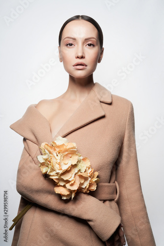 Fotobehang womenART Fashion beautiful lady in beige coat