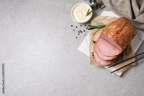 Fotografia Delicious ham served on grey table, flat lay. Space for text