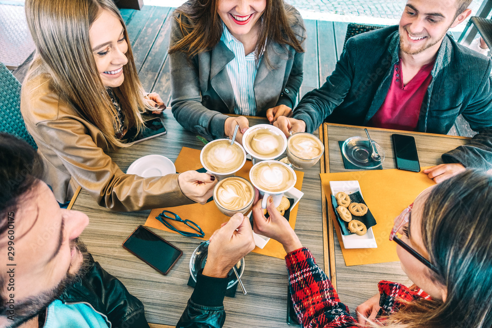 Fototapety, obrazy: Top view of happy friends toasting cappuccino drink at coffee shop restaurant - Millennial people group having fun on breakfast together at fashion cafe bar - Friendship concept on vivid warm filter