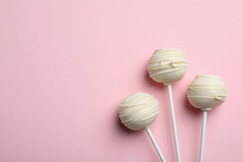 Sweet Cake Pops On Pink Background, Flat Lay. Space For Text