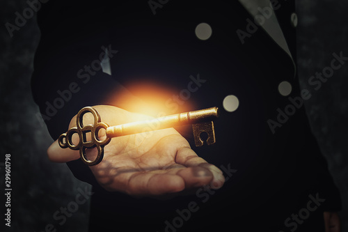 Close up image of a business person holding a shining key Canvas Print