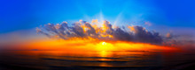 Panorama Of Sunset With Lighted Clouds On The Sea