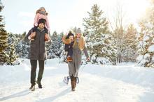 Happy Family Sledding In The P...