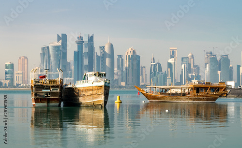 Vászonkép  Old Wooden Boats and Dhows in Doha Bay and Skyline of West Bay in Distance (City