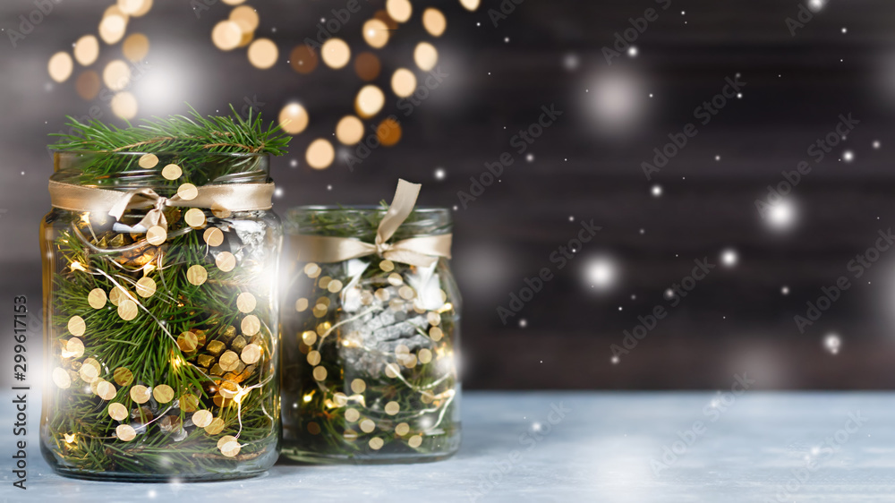 Fototapety, obrazy: Christmas decoration handmade in glass jar with lights, fir tree, pine cones. Christmas still life on black wooden background, copy space