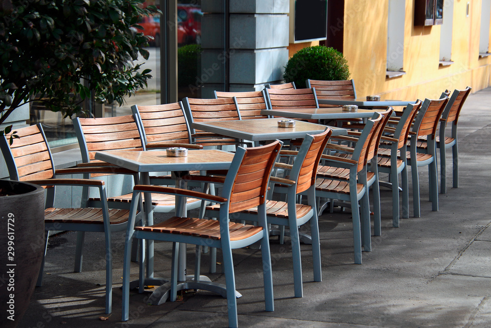 Fototapety, obrazy: chairs in front of tables with ashtrays in an outdoor cafe